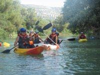 Downhill in canoes