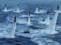 A group practicing flyboard