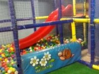 Slide that lands in a ball pool