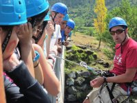 boys with blue helmets doing multi-adventure activities