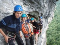 young people in a mountain practicing via ferrata