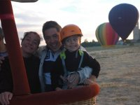 The kid with parents on balloon