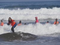 Students in the waves