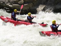 Canoas biplaza en aguas bravas