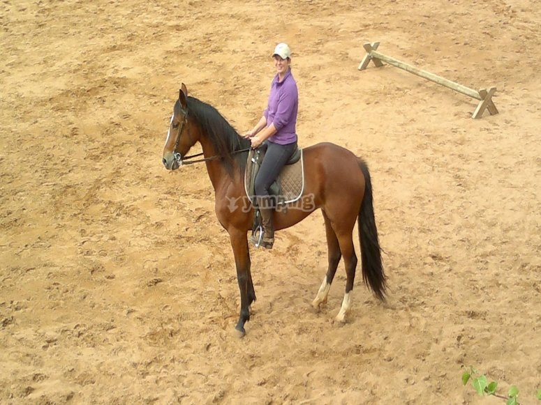 Sitting on horseback