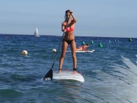 Girl on paddle surf board