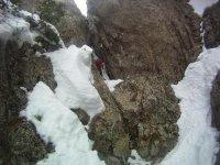Snowy abseiling