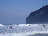 Kayaks between waves