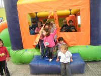 group of children in inflatable castle