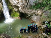 Canyoners gathered under the waterfall