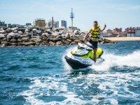 With the jet ski on the coast of Gijón
