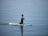 Kneeling on the paddle surfboard