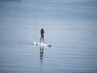 Paddling on the paddle surfboard
