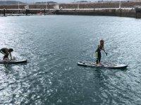 Maintaining balance on paddle surf boards