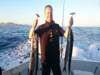 Pescador con peces