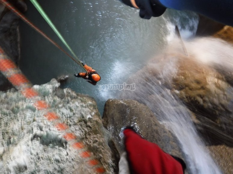 Canyoning descent with rope