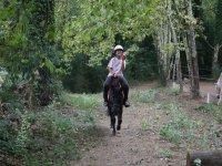 Sonriendo desde el caballo