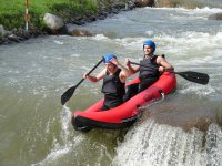 Down the waterfall in a two-seater inflatable kayak