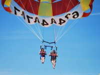Friends in parasailing