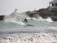 Paddle Surf cogiendo la ola