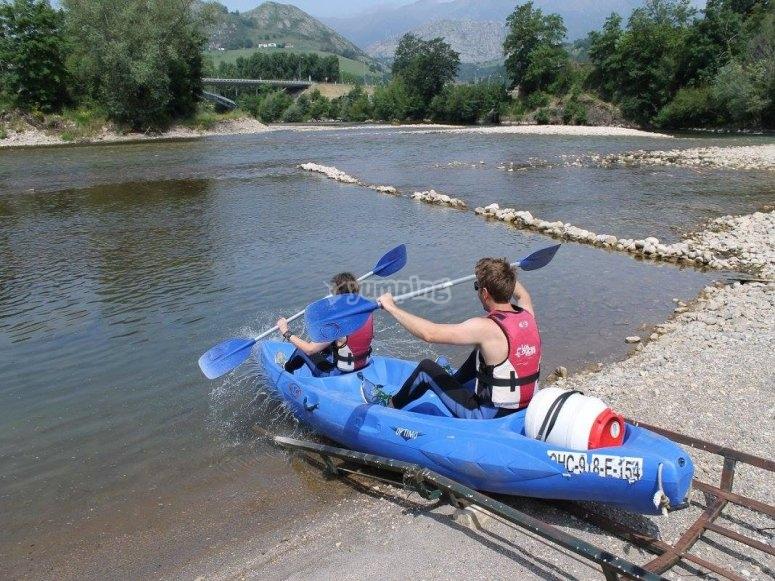 canoe entering the river
