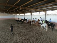Giving a class in the horse riding centre