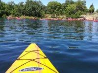 Canoe approaching the riverbank