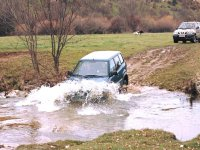 Off-road vehicle passing through water section