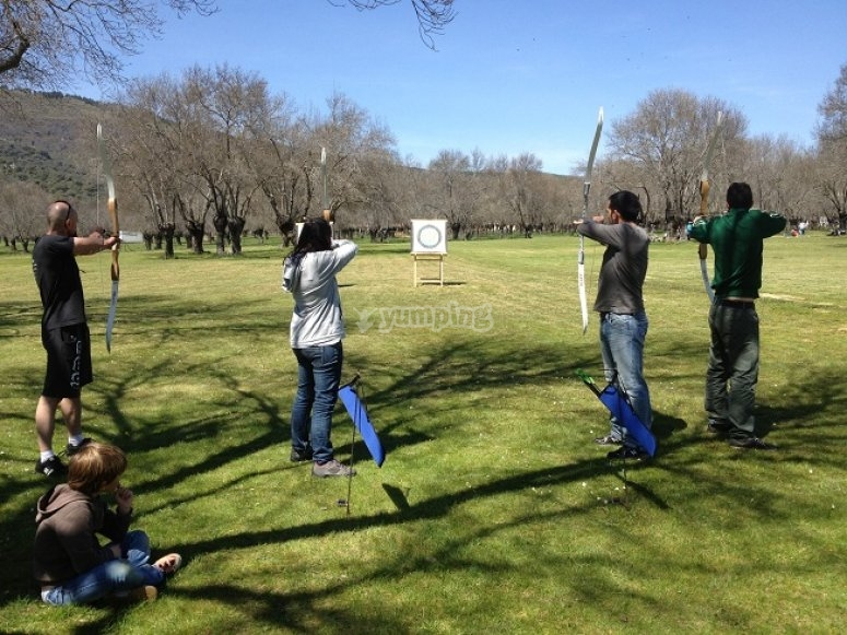 Group practicing archery