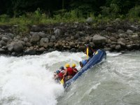 Raft fighting against the river
