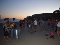 Percussion on the beach at night