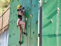 At the outdoor climbing wall