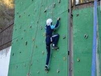 Young boy climbing the climbing wall
