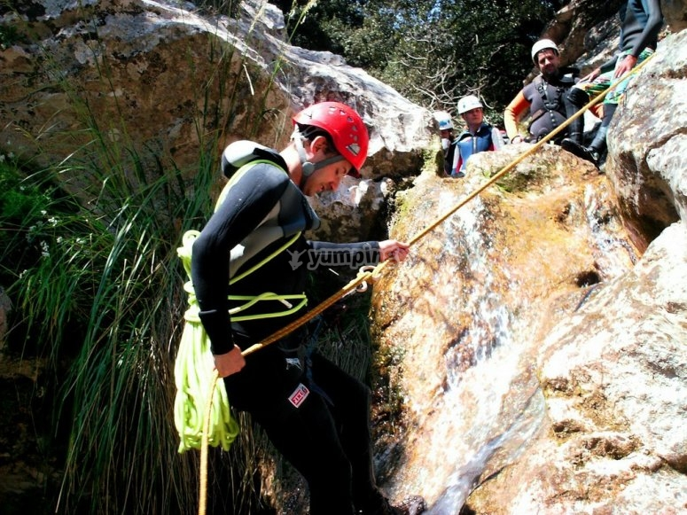 Rappelling in the river