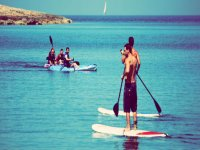 Practicing paddle surfing in the waters of Almería