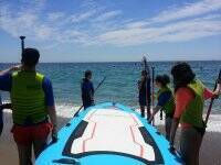 Enjoying with friends while paddle surf XXL practice in the Mediterranean