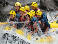 Group of friends rafting