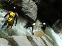 Friends having fun with canyoning initiation
