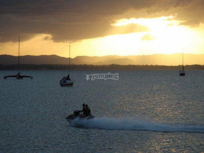 Driving the jet ski at sunset