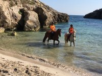 Horse riding to Cala Fustam