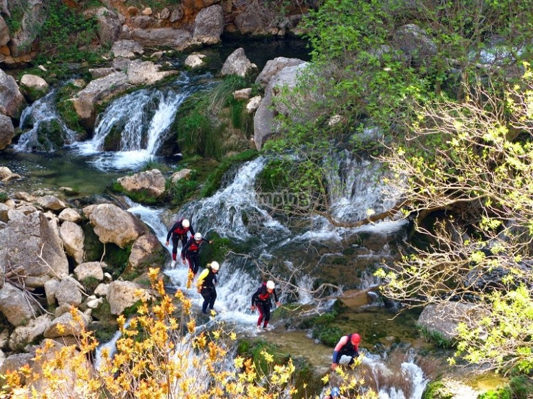 Boys practicing canyoning in Cuenca