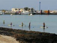 Clases prácticas de paddle surf.