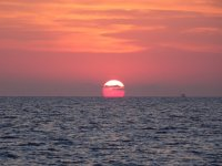 Enjoying the sunset on the high seas