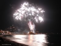Fireworks during paddle surfing, in Blanes