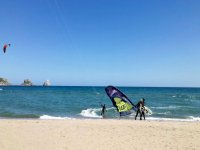 Putting the windsurfing equipment in the sea
