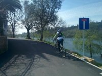 by bicycle next to the river mino