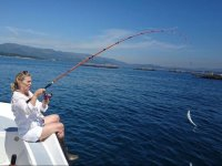 Fishing whilst sitting in the boat