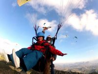 Paragliding with open arms
