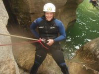 Descending into the water by rappelling