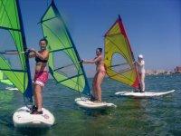 Friends practicing windsurfing
